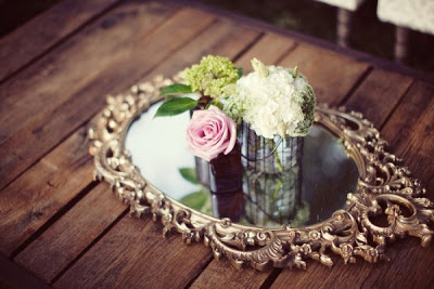"""Fairytale Inspired Table Centerpiece  """" Centerpieces aren't just about flowers these days. Couples are using a mix of props, florals and unexpected twists to express their wedding style."""" - Wedding Illustrated"""