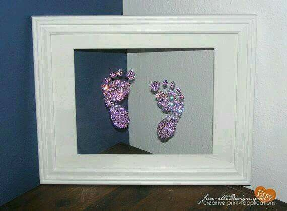 Baby foot prints in glitter. Post said coat feet in Elmers glue, place on glass, the pour glitter over prints.