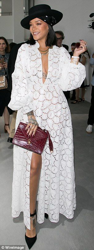 Rihanna shows off cleavage in plunging white lace dress