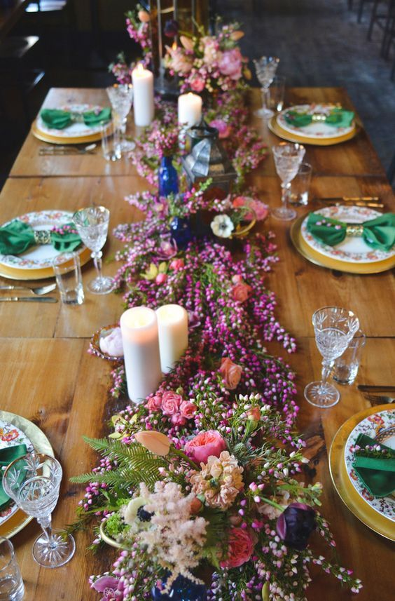 A Floral Table Runner in Heather, Anemones, Astilbe, and Wildflowers / http://www.himisspuff.com/boho-rustic-wildflower-wedding-ideas/