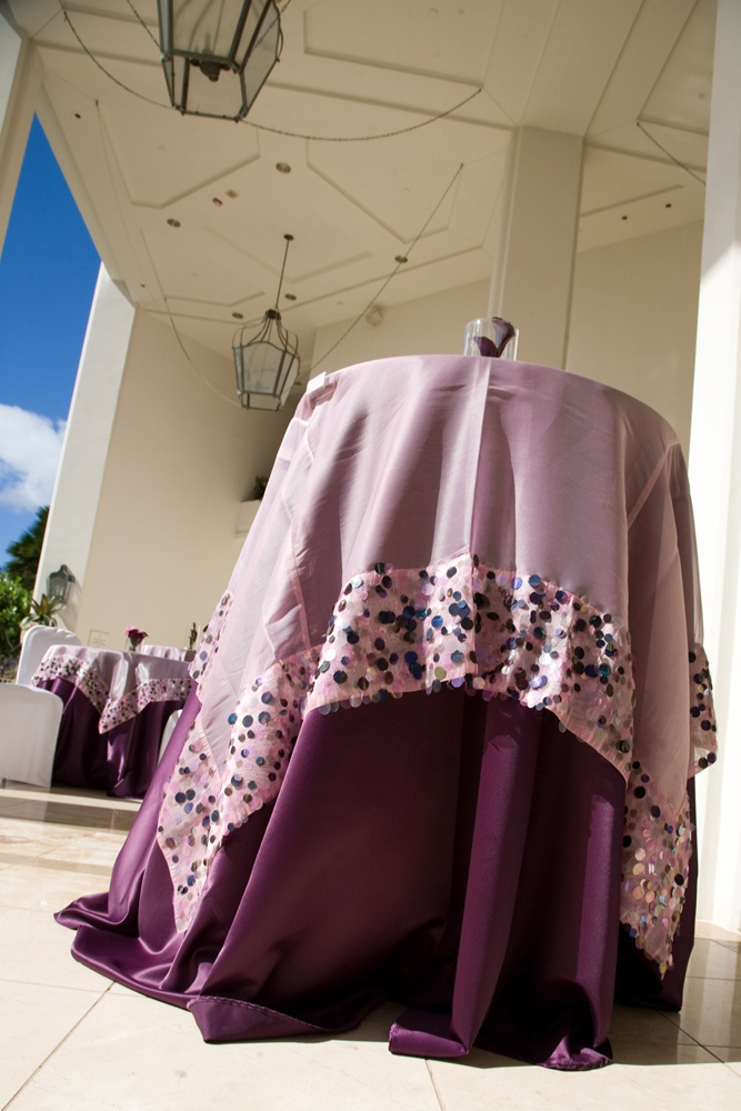 A Sheer Overlay Trimmed With Pailettes Layered Over A Purple Satin Linen  Add A Modern And
