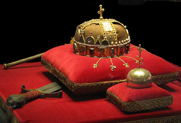 "11th c. Holy Crown of Hungary (Magyar Szent Korona). The base ""corona graeca"" originated as a Byzantine woman's crown, remodelled then given to the Hungarian queen by Emperor Michael Dukas VII c.1075. The ""corona latina"" has Latin inscriptions whose style indicates a mid-11th c. date, and was almost certainly recycled from a reliquary or liturgical object. The cross was probably added in the 16th c. and knocked askew in the 17th c."