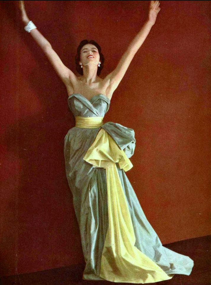 Taffeta 1950 - Sylvie Hirsch in strapless taffeta evening gown sashed and draped to to the side in contrasting lemon, by Christian Dior