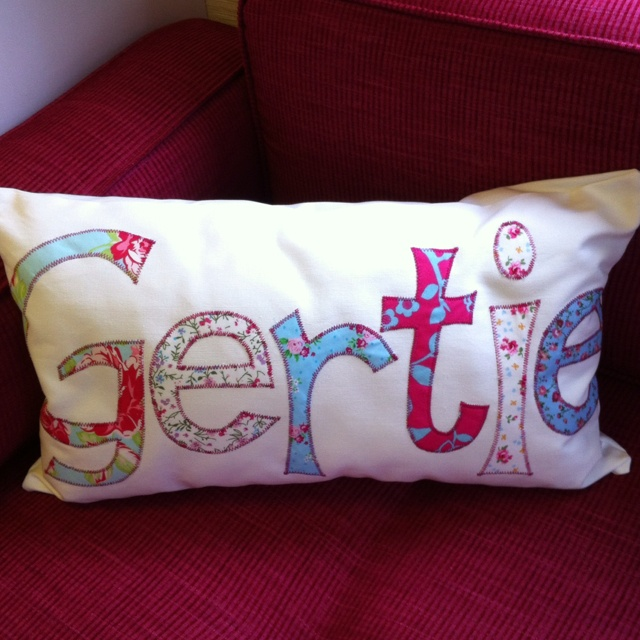 Gorgeous personalised cushion on Gertie's new raspberry sofa