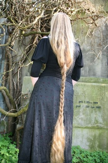 Very long hair, what a nice way to wear a plait but give the impression of loose hair. We met a girl with hair this long once. It was glorious. She said it took a week to dry and gave her headaches from the weight.