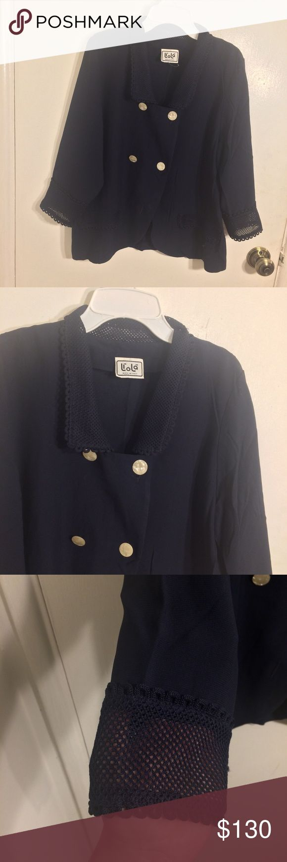 Liola Made In Italy Jacket Liola Made In Italy navy blue collared button up adjustable Blazer jacket with eyelet lace trim along the sleeve ends, collar, and pocket flaps. Pearlescent opal-like buttons. Adjustable, meaning it can been worn a number of different ways/styles depending on how you button it up. Like new condition. Flawless perfect condition. Liola Jackets & Coats Blazers