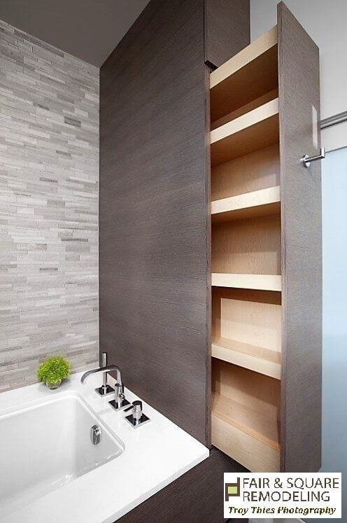 Hidden Sliding Shelf in a Small Bathroom