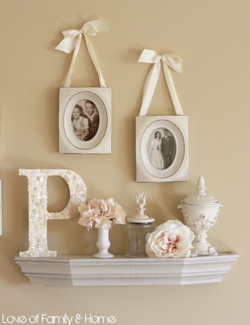 ribbon frames, monogram P, and pretty flowers-- this would be pretty on the mantle.