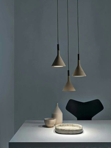 The Foscarini Aplomb Suspension Lights are concrete drop lights that look great either singularly or as a cluster.