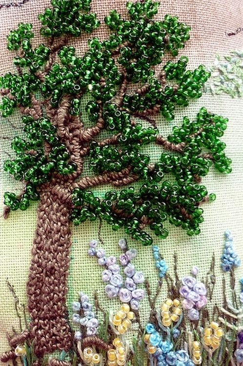 This is a mixed bag. Embroidery, beading and ribbon work evoking a 3D effect. Quite striking, especially the leaves.