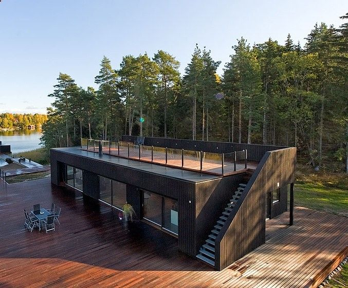 Container home with upper deck. It'd be even nicer with grow/garden beds in the empty space around the deck.