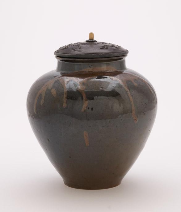 Storage jar, probably Tamba ware  19th century      Edo period or Meiji era     Stoneware with iron and ash glazes; metal lid added later for display  H: 16.5 W: 16.5 cm   Tachikui, Japan
