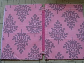 """Perfect pouch tutorial - best tip - sew tabs at end of zipper, then make pouch 1.5"""" wider than zipper.  When sewing lining and exterior seams, sew close but not through zipper tabs.  Beautiful."""