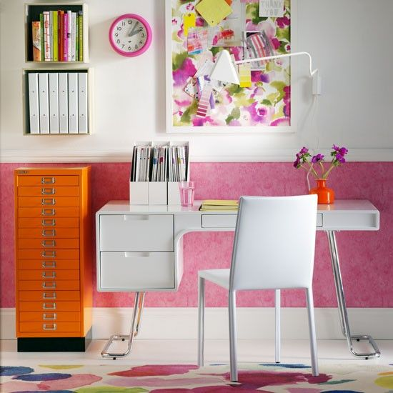 Pink and orange home office with sleek white desk