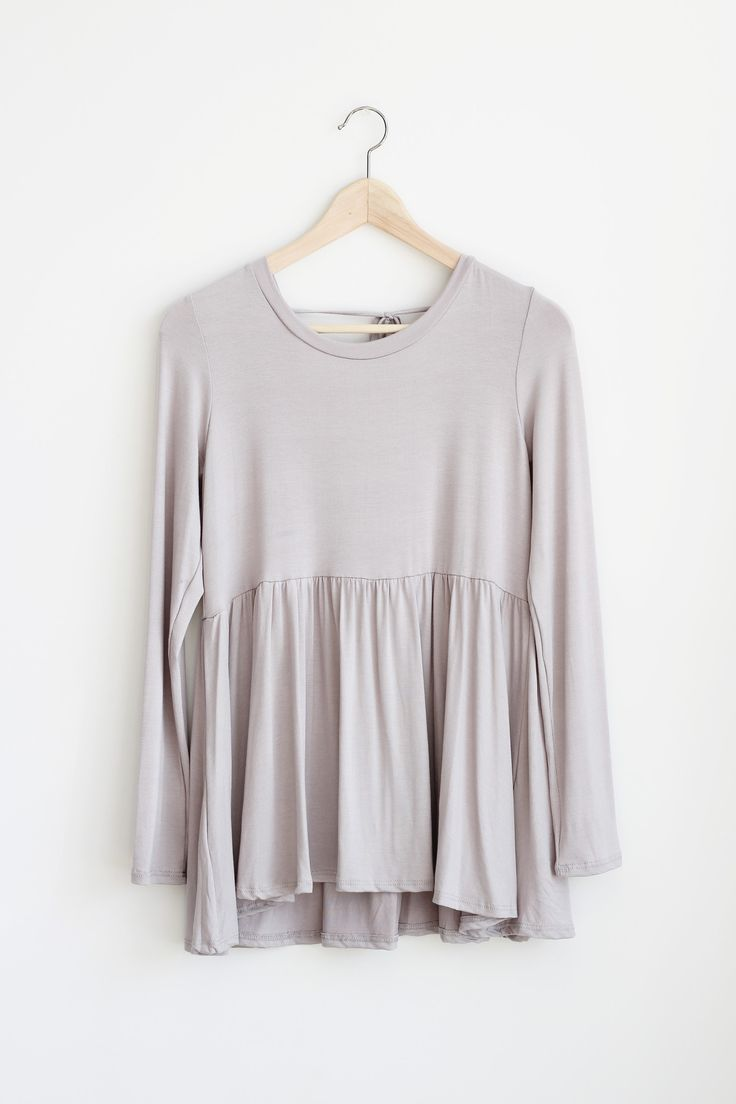 - Details - Size - Shipping - • 95% Rayon 5% Spandex • Loose fit, round neck, long sleeve peplum top. Has shirring detail at waist. Scoop V-back with tie detail. This peplum top is made with heavyweig