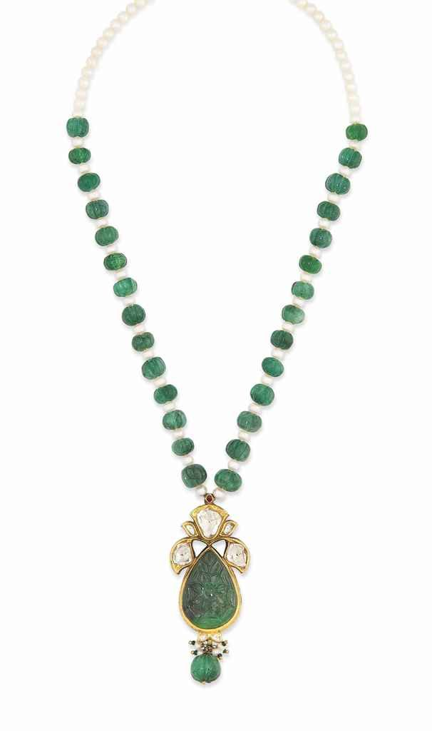 A carved emerald and gold enamel pendant India, 19th century