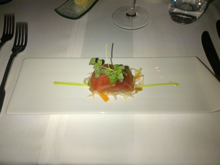 Tuna sashimi on a glass noodle salad with carrots and basil cress on a wasabi stripe @ Restaurant loca - better eat better