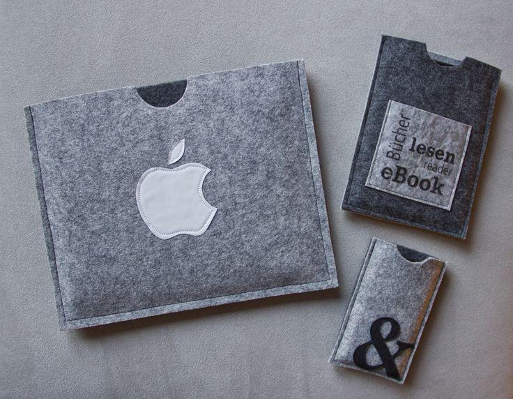 """Filz zu Handyhülle, eBook-Hülle und iPad-Hülle vernäht. e-Book-Hülle: mit Transferpotch habe ich auf dem Laserdrucker spiegelverkehrt die Worte gedruckt und danach auf den Filz aufgebracht. iPad-Hülle: der """"Apfel"""" wurde aus einer Kaffeetüte ausgeschnitten und auf den Filz aufgenäht. Handy-Hülle: das &-Zeichen wurde aus dünnem Filz ausgeschnitten und ebenfalls aufgenäht"""