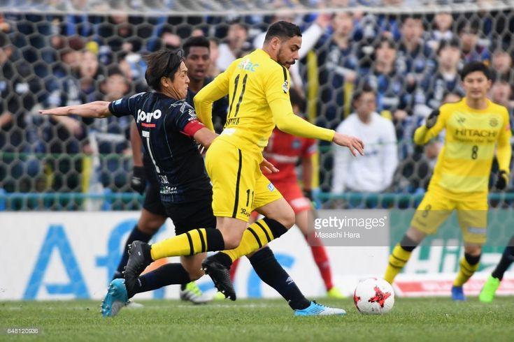 Diego Oliveira of Kashiwa Reysol and Yasuhito Endo of Gamba Osaka compete for the ball during the J.League J1 match between Kashiwa Reysol and Gamba Osaka at Hitachi Kashiwa Soccer Stadium on March 5, 2017 in Kashiwa, Chiba, Japan.