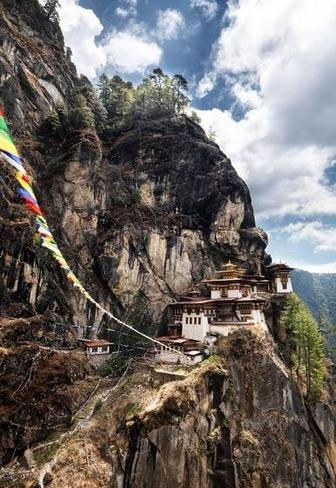 Cloistered Bhutan - BBC Travel The fabled Taktshang Goemba, or Tiger's Nest monastery, is perched on one of the steepest jagged cliffs that rises from the Paro valley. Tigers still prowl the surrounding mountains.