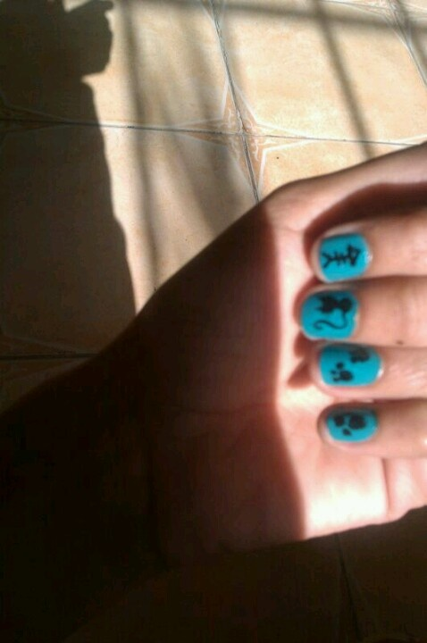 Nail art, using a nail paint, nail coat and an eyeliner