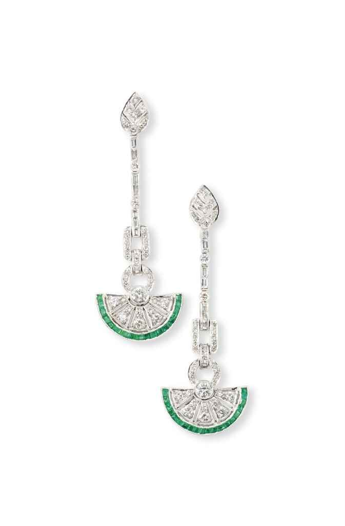 A PAIR OF DIAMOND AND EMERALD EARRINGS Each circular-cut diamond-set pierced fan-shaped drop with calibré-cut emerald edging, to a baguette and circular-cut diamond line suspension and foliate surmount, post fittings, 5.7cm