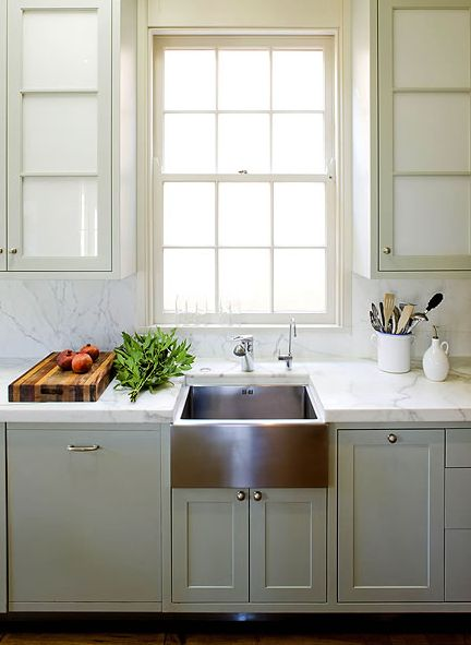 White counter, stainless farmhouse sink, grey cupboard bottoms, white cupboard tops with glass. Exactly what I want!!