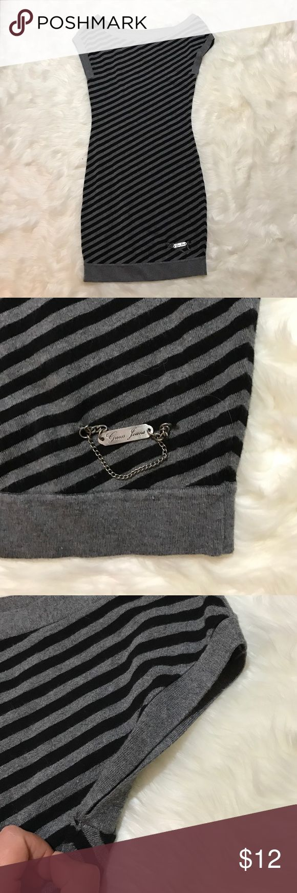"Guess Los Angeles striped bodycon dress Guess Los Angeles black and gray bodycon dress size medium. There is a small hole in the underarm area. Please see photo. Bust 14"", length 28"" Guess Dresses Mini"