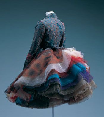One of the best and attractive dresses presented by Vivienne - rather a simple vest and a skirt decorated with a lot of beauty colored ruffles...