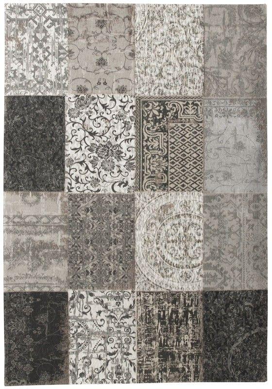 Zwartwit patchwork vloerkleed met vintage uitstraling