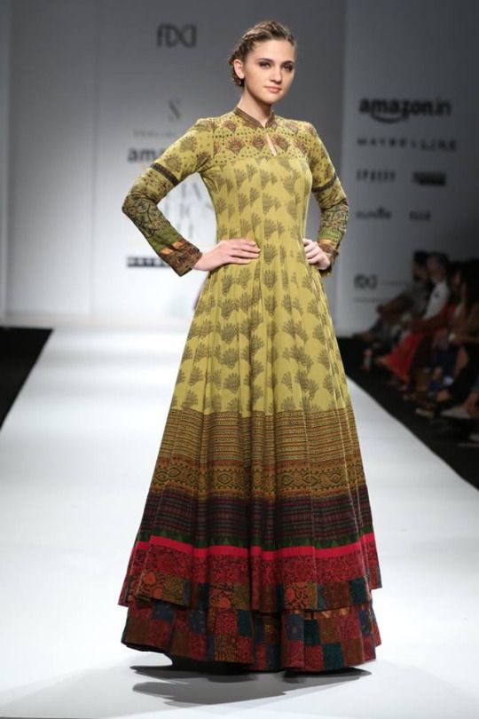 This woman looks 7 foot tall or in stilts.. but I do want to wear this. I love the patch worked bottom it adds so much texture. From Mantra Design Studio.