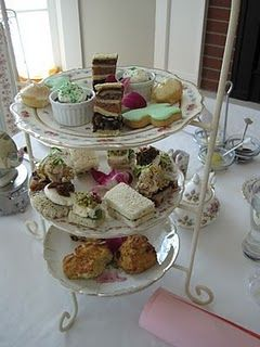 In England an afternoon tea normally consist of 3 layers. A scone layer, sandwich ( and other types of hearty food) layer, and finally a dessert layer! My favorite is the sandwich layer. It has my favorite cucumber sandwiches and the meat pies!