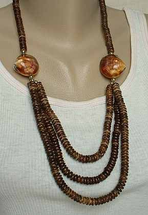 This wonderful necklace has a great design, with the front being a triple strand of coconut wood beads attached to two shellacked shells. The shells are very beautiful ...
