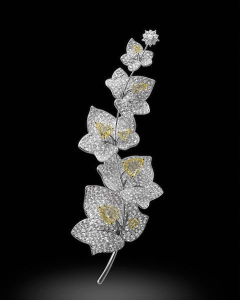 White diamond and fancy intense yellow diamond brooch in platinum, white and yellow gold, by Michelle Ong for Carnet. @carnetjewellery_bymichelleong #yellowdiamonds #natureinspiredjewelry