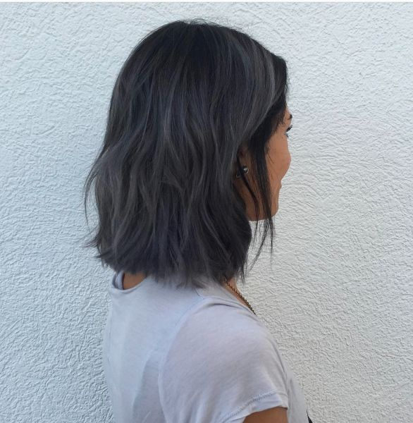 Stylist @mckenziebyrdhair makes hair magic with this cool, blue-grey Aveda Color. Color formula in the comments.