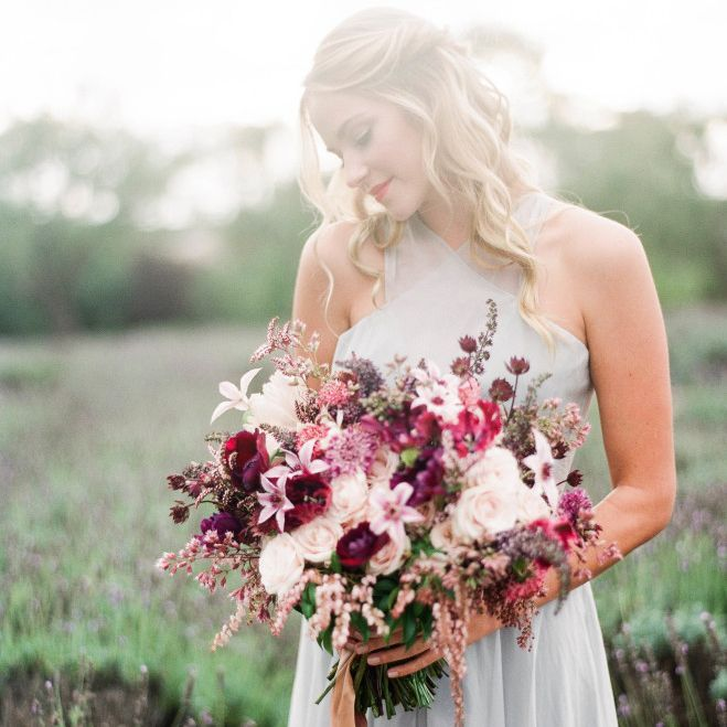 Frosted lavender hues mixed with warm neutrals and bold pops of berry make for a winter purple wedding that's seasonally chic and anything but chilly!
