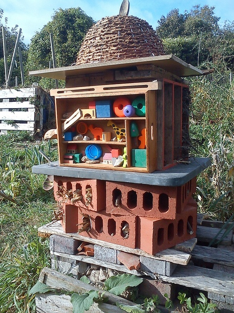Love this bug hotel! #homesfornature  A CLASSIC OF SORTS, REPRESENTING HEIGHT OF 'POPULAR' PLACE OF ORIGIN.