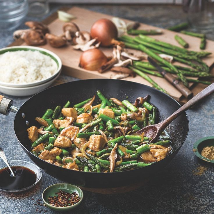 A stir-fry of tender chicken, bright green asparagus and earthy shiitake mushrooms. Before you prepare the stir-fry, start the rice so you'll have a complete dinner on the table in less than 30 minutes.