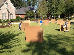 Nerf party...cardboard barricades...use wooden sticks stapled to cardboard pieces and stuck in the ground....easy!