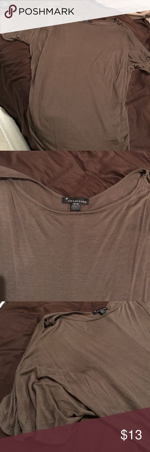 Forever 21 hunter green short sleeved top Gorgeous dark hunter green tshirt with cinching on each side of shirt near waist. Fits looser on stomach area. Top shows off one shoulder slightly. Worn once. Excellent condition. Forever 21 Tops
