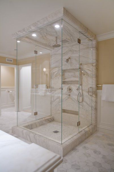 Don't you think the prettiest bathrooms look even prettier with frameless glass shower doors? They make the space appear bigger and brighter and they let more light in when you are showering away. Read today's blog for tips on selecting glass shower doors!