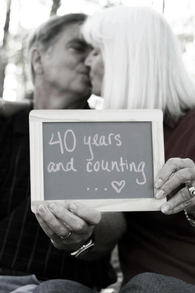 cute pic idea.. create plaques of cute sayings or quotes they could hold in photos ---serious and humorous