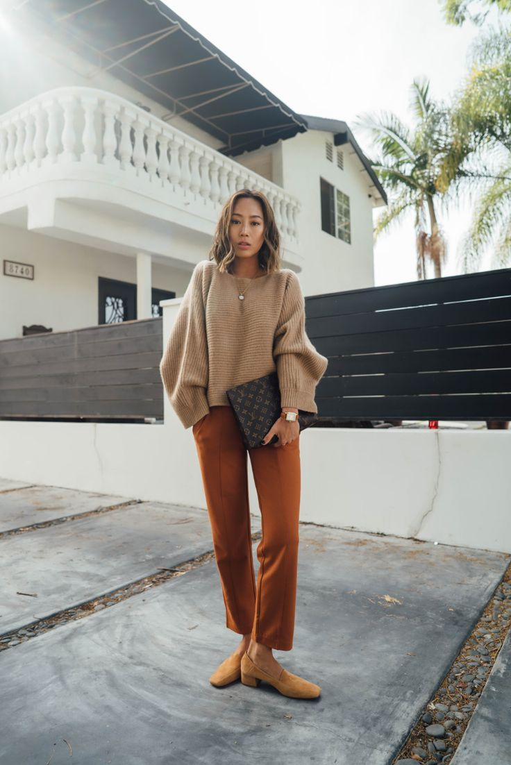 Boxy Camel Sweater+brick red pants+and mustard Suede Pumps+Louis Vuitton clutch+necklace. Fall Dressy Casual Outfit 2017