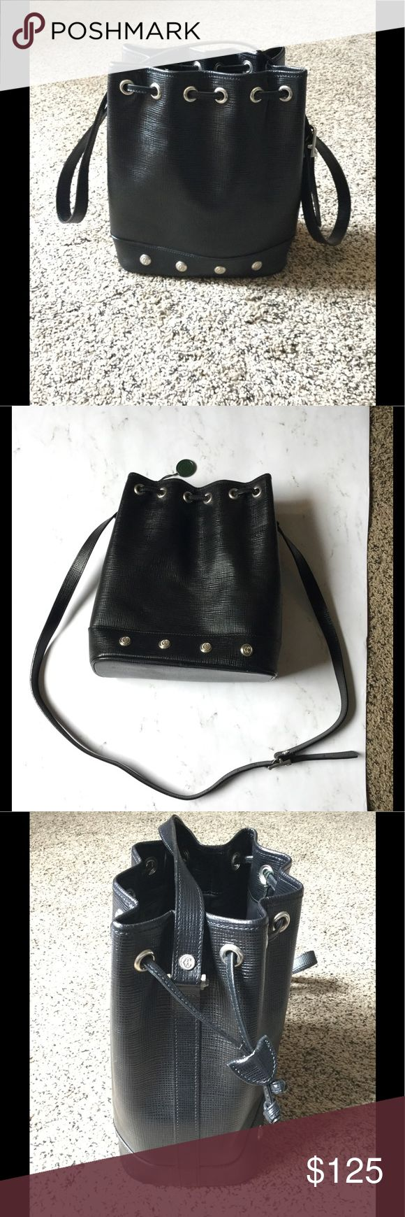 """🌟 Authentic Philippe Charriol bucket bag🌟 This is a beautiful Made In France bag. That features a glossy black textured leather. This bag also has, silver hardware all around the outside with a zippered pocket inside and a silver hang tag that features the designers logo. Bag also has adjustable strap, longest length 22 1/4"""". Shortest length 19"""". This bag can be worn as a cross body when out with the kids. ✨IN GREAT CONDITION✨ Philippe Charriol Bags Shoulder Bags"""