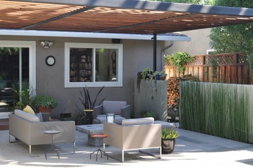patio...like how they extended the fence from side of house (on side yard) a little more privacy.