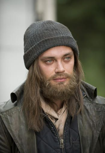 Tom Payne, The Walking Dead, wearing a false moustache and beard and long haired wig.