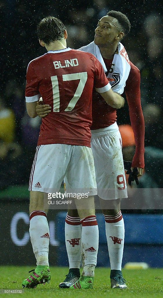 Manchester United's Dutch midfielder Daley Blind (L) and Manchester United's French striker Anthony Martial react at the final whistle during the FA cup fourth round football match between Derby County and Manchester United at Pride Park stadium in Derby on January 29, 2016. Manchester United won the match 3-1. / AFP / OLI SCARFF / RESTRICTED TO EDITORIAL USE. No use with unauthorized audio, video, data, fixture lists, club/league logos or 'live' services. Online in-match use limited to 75…