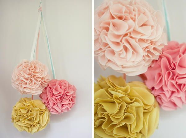 Easy DIY fabric pom poms for little girls room or party decor.