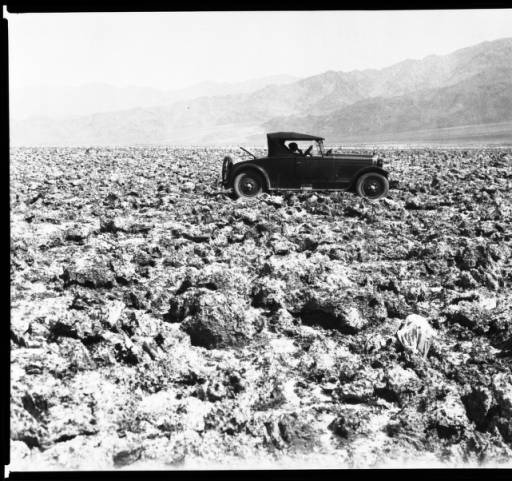 """Early-model automobile at the """"Devil's Golf Course"""" area of Death Valley, ca.1928 :: California Historical Society Collection, 1860-1960"""