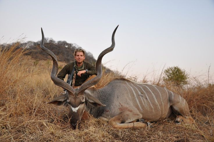 Back in 2012, photos surfaced of the elder Donald Trump's sons, Donald Trump Jr. & Eric Trump, proudly posing with the carcasses of dead animals they hunted while on a big-game hunting expedition in Africa. The photos showed Donald & Eric posing with a lifeless cheetah, Donald clenching a knife along with the bloody, sawed-off tail of an elephant, & the pair posing next to a crocodile hanging from a noose off of a tree.